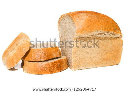 loaf of bread with chopped pieces on a white background. white bread loaf isolated. Loaf of bread isolated on white background