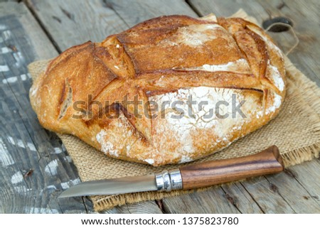 loaf of floured bread #1375823780