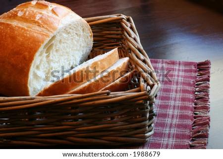 Loaf of fresh bread in a wicker basket.