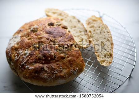 Loaf of home made artisan bread  with olive. still life