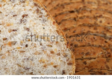 Loaf of sliced brown bread, texture close up