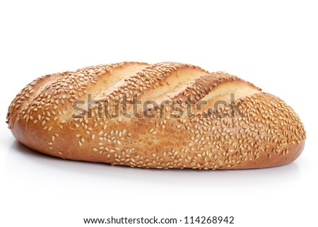 loaf of white bread with sesame seeds on a white background