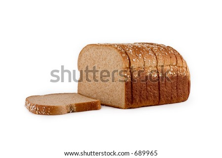 Loaf of whole wheat bread isolated on white background with clipping path outline.