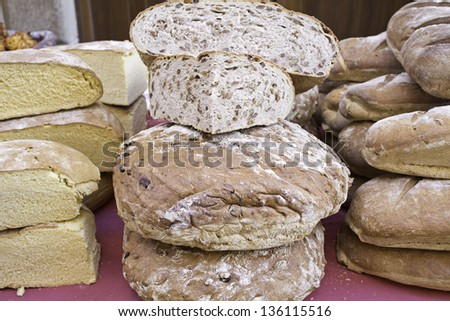 Loaf with flour and seeds, bakery in feed market