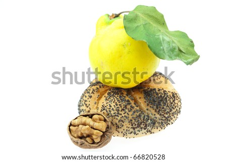 loaf with poppy seeds, quince and walnut isolated on white