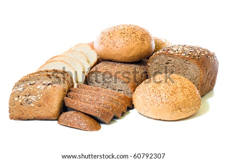 loafs of whole wheat and  rye bread isolated on white background