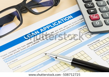 Loan application form with calculator, glasses, and pen #508712725