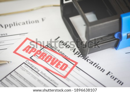 Loan application form with Rubber stamping that says Loan Approved, Financial loan money contract agreement company credit or person - loan approval