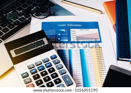 Loan concept, Loan Calculator paper with calculator, computer labtop, notebook and smart phone on the table.