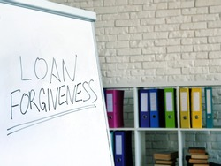 Loan forgiveness inscription on the white board in the office.