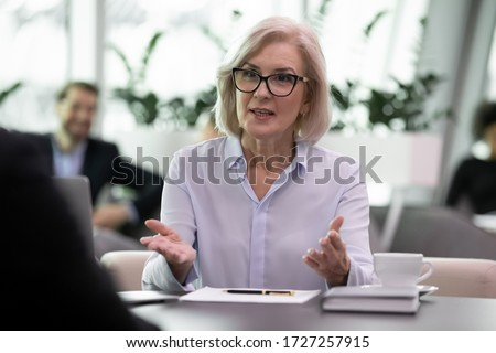 Loan officer negotiating with bank client about credit application, business entities parties meeting activity concept, during job interview middle-aged boss ask question applicant focus on hr manager