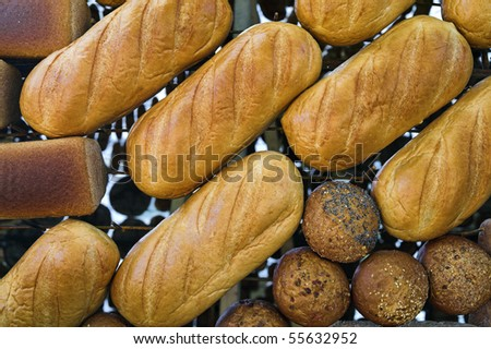 Loaves of bread put out at grocery stand