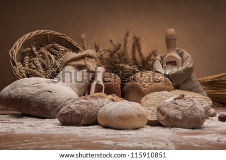 Loaves of bread, rolls and vegetables - stock photo