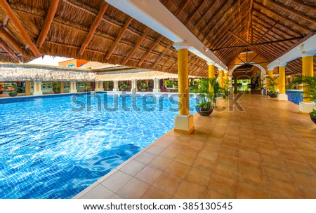 Lobby, gallery, promenade of the  luxury caribbean, tropical hotel, resort. Reception area. Interior design. - Shutterstock ID 385130545