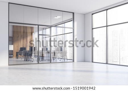 Lobby of spacious office with white and glass walls, concrete floor, panoramic windows and open space office with black computer tables and bookcase. 3d rendering