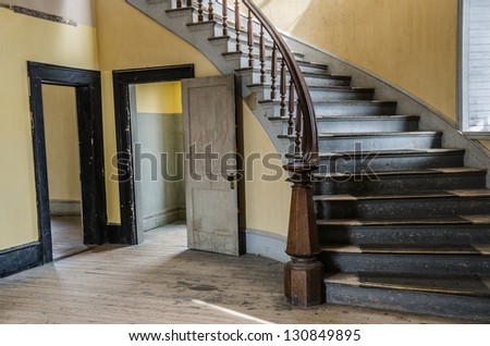 Lobby of the Hotel Meade with a beautiful staircase now used by park visitors and ghosts at Bannack State Park in Montana.