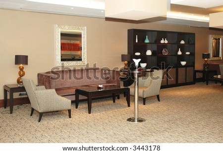 Lobby of the hotel with  sofas and shelves