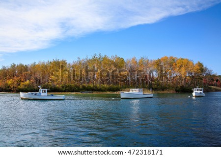 Lobster boats at rest on a sunny autumn morning in Kennebunkport Harbor, Kennebunkport, Maine, USA #472318171