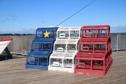 Lobster cages in Acadian flag colours, Shippagan, New Brunswick, Canada