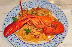 Lobster crayfish pasta eat lunch in restaurant. Seafood dish lobster spaghetti pasta on dinner. Cooked steamed red crustacean crayfish & italian pasta. Boiled lobster noodles. Crayfish crab food plate