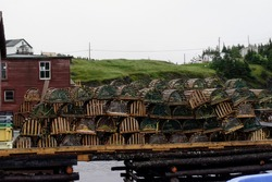 Lobster pots piled high on a wharf in outport Newfoundland and Labrador, Canada