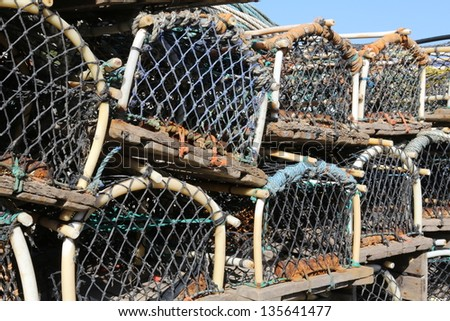 Lobster pots stacked on a fishing quay