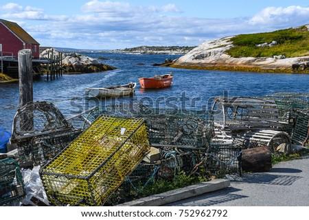 lobstering gear piled on a pier ...