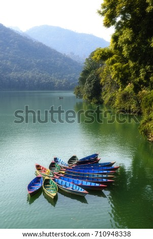 Local nepal boat floating in water at fewa lake ,travel destinations in Pokhara,Nepal #710948338