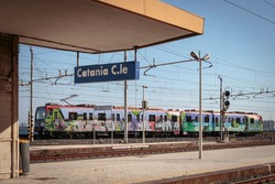 Local train arriving at an empty platform in Catania, Sicily