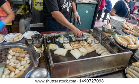 """Local vendor of Taichung Second Public Market. Old market has always been the favorite of backpack travellers. Taichung, Taiwan. Text in Chinese means """"Government Uniform Invoice unnecessarily"""" #1490727098"""