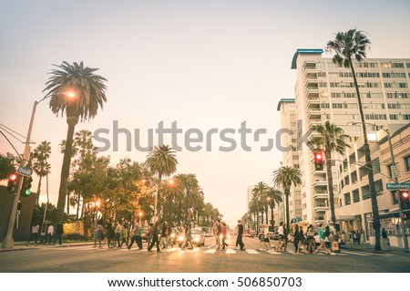 Shutterstock Locals and tourists walking on zebra crossing on Ocean Ave in Santa Monica after sunset - Crowded streets of Los Angeles and California state - Warm desat twilight color tones with blurred people