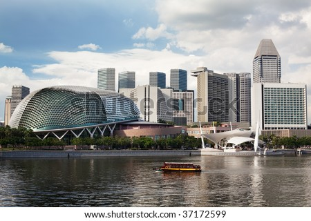 Located at Waterfront, Marina Bay, mouth of Singapore River. The Esplanade is a world renowned  performing arts centre.  Its twin domes are nicknamed as the Durian #37172599