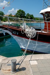 Located in the North-East region of dobrinj, Island Krk in Croatia to the Adriatic Sea. Ropes bound to the port Jetty for tourists, holidaymakers, yachts, boats, clearing.