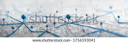 Location marking with a pin on a map with routes. Find your way. Adventure, discovery, navigation, communication, logistics, geography, transport and travel theme concept background.