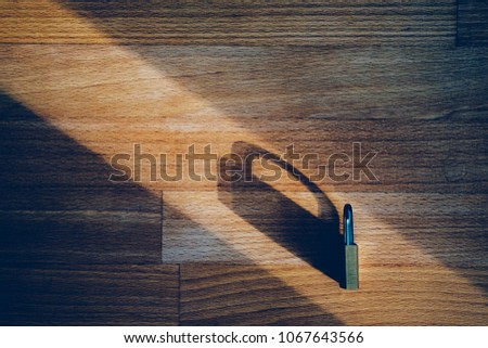 lock as symbol for Privacy and General Data Protection Regulation on wooden table