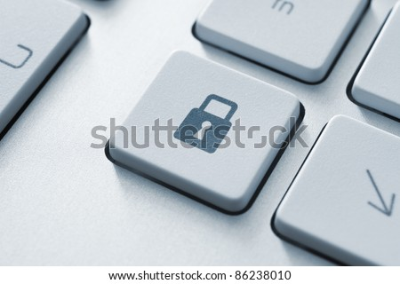 Lock button on the keyboard. Toned Image.