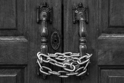 Lock down the door by iron chain