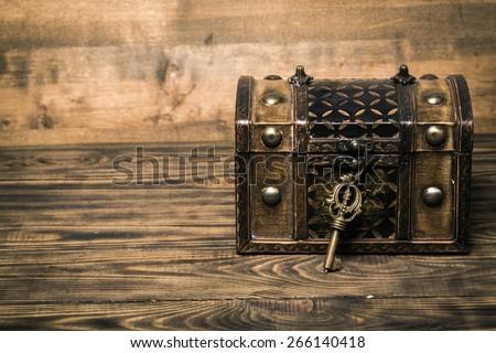 Lock, key, chest.