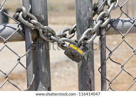 Lock on a chain link security fence.
