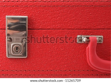 Lock on a red vintage suitcase