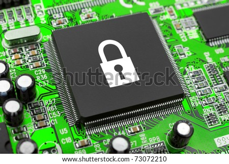 Lock on computer chip - technology security concept - stock photo