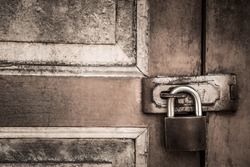 lock on the door of an old farmhouse