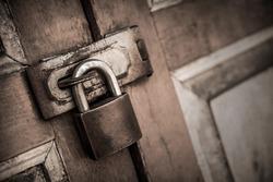 lock on the door of an old farmhouse . true village style.