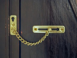 Lock the door with a door chain