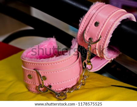 Lock the handles on the bed. Leather belt for wrist (handcuff) - Shutterstock ID 1178575525