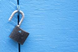 lock unlock blue door background template security business concept