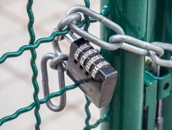 locked border with fence and lock
