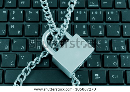 Locked chain on computer keyboard