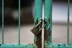 Locked fence by padlock, security protection concept.