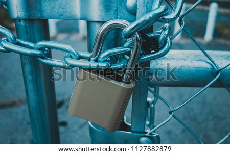 Locked Gate/Boarder Tethered by metal chain and padlock. Toned photo. Closed borders immigration concept.  stock photo